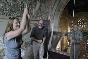 An image from All Saints Church's 2011 flower festival showing bell ringers in action