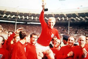 Bobby Moore holds aloft the Jules Rimet World Cup trophy in 1966 Picture: Popperfoto/Getty Images)
