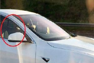 Patel, circled, was filmed sitting in the passenger seat
