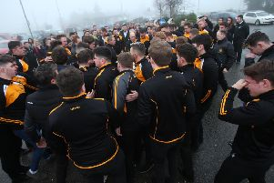 A crowd of mourners at the funeral of Christopher Colhoun yesterday