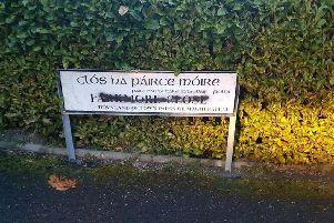 The vandalised street sign in Parkmore Close.