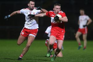 Derry's Sean Quinn takes on Kyle Coney of Tyrone in Celtic Park.