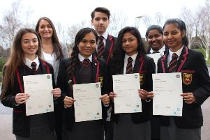Koren, Graziela, Eriks, Elissa, Sherin and Fizela pictured with Mrs Doherty, receive their certificates at the Senior Prizegiving.