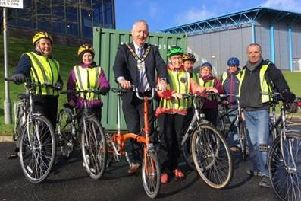 Chair of Mid Ulster District Council, Councillor Sean McPeake with the participants of a brand new cycling pilot scheme at the cycle pod in Dungannon Leisure Centre.