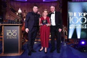 Pictured L-R Brian O'Driscoll, Rosemary McAleer, McAleer's Bar, Dungannon, and David Jordan, Henderson Foodservice at Hospitality Ulster's Top 100 Hospitality Business Awards at Titanic Belfast.  Picture by Kelvin Boyes/Darren Kidd, Press Eye.