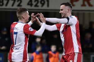 Linfield's Andrew Waterworth (right) celebrates