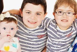 Sharon and Mark are devoted parents to their children: Isabella, Aaron and Joshua (pictured left to right)
