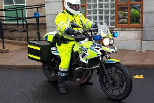 Officer prepares to carry out duties at today's Cookstown 100.