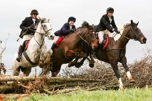 Charity Chase riders George, Lizzy and Rachael Graham testing their horsemanship.