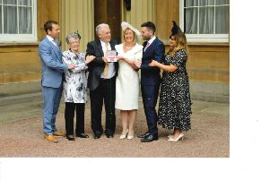 Imelda pictured with her family Gavin, Sadie, Andrew, Duane and Adnrea at Buckingham Palace