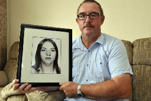 Gerard Beattie with a photograph of his late sister, Marian. INPT32-100gc