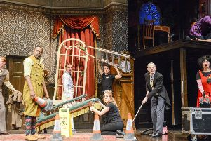The cast of The Play That Goes Wrong during a chaotic moment.
