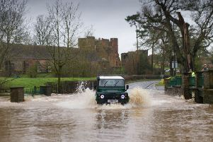 With significant rainfall over Easter Sunday evening and into Easter Monday flood alerts were issued by the Environment Agency for some part of the Midlands on 2 April 2018. A motorist braves the flooded Ford on the A452 at Kenilworth, Warwickshire on 2 April 2018. Photo: Fraser Pithie
