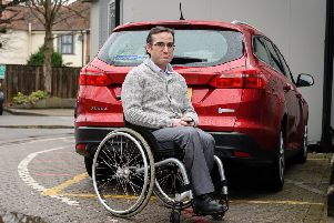 Simon LaBarbera has not had his disability benefit since December 2017. He missed an assessment in November when the benefit changed from Disability Living Allowance to Personal Independence Payment, and has not been reassessed since. Simon uses a wheelchair, and is worried he will lose his Motability car, which will cost him his livelihood. NNL-181004-183927009