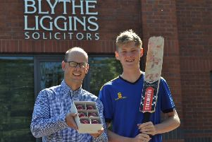 Kevin Mitchell, commercial solicitor and partner at Blythe Liggins, presents the balls to Dan Mousley.