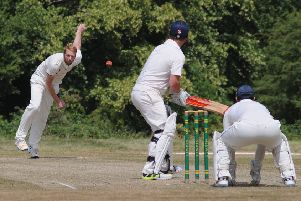 Wellesbourne's Jamie Maynard bowling to Norton Lindsey's Steve Rushton. Picture: Morris Troughton