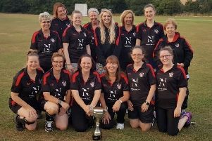 Southam's ladies celebrate with the Bob Coop Memorial Cup.