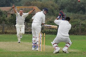 Warwick 2nds' Craig Patterson celebrates after bowling Hunningham's Alan Staniforth. Picture: Morris Troughton