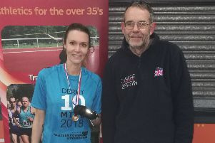 Wendy Daniels receives her medal for winning the W40 category at the Derby 10.  Pictures submitted