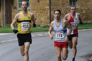 Paul Andrew battles it out with Richard Shephard in the early stages of the Ilmington 10k. Picture: Barry Cornelius (www.oxonraces.com)