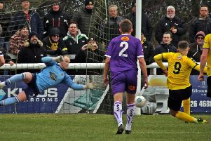 Colby Bishop's penalty beats Anthony Thompson despite the Altrincham keeper guessing the right way. Pictures: Sally Ellis