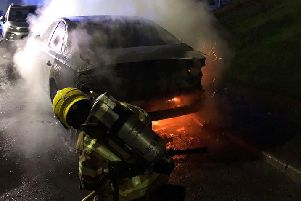 A firefighter used a hose reel to extinguish the burning Audi. Photo: Kenilworth Fire Station.
