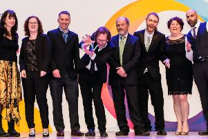 The team at Lamp celebnrate winning the the National Autistic Society Award for Professionals - Inspirational Education Provider 2019.'Photo courtesy of www.aaronscottrichards.co.uk