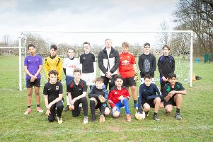 Jordan Shipley joined school footballers for a team shot
