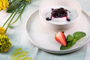 Coconut pudding with berry compote
