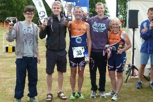 Kate Vanloo (right) with members of Rugby Triathlon Club