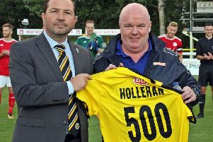 Paul Holleran is presented with a special shirt by Simon Davies to mark his 500th game in charge. Picture: Sally Ellis
