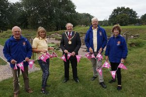 Pictured with the chairman of Warwick District Council Cllr George Illingworth are the custodian of Bagots Castle David Hewer, secretary Delia Whittle, and two of the sites nine volunteers Rheba and Roger Horsfall.
