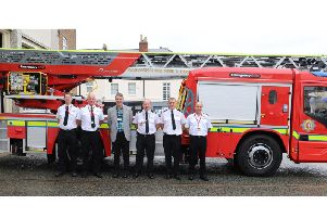 Andy Crump and firefighters with the new appliance.
