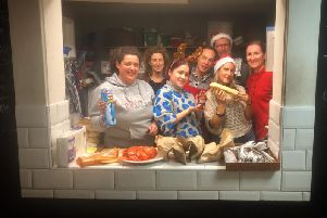Spa Centre staff help out at a Helping Hands soup kitchen