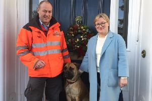 Royal Mail Postman Steve Malin with Peggy and her owner, Alice Broadfield