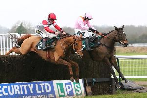 Manofthemoment, right, jumps the final fence alongside Summit Like Herbie in the LPS Handicap Chase. Picture: www.dwprattracingphotography.co.uk