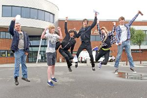 Students jumping for joy at Shoreham Academy DM155515a