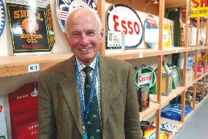 Automobilia specialist Gordon Gardiner with an array of motoring collectables at Toovey's.