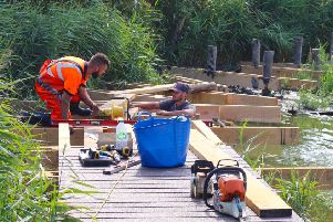 Work to install the new boardwalk at the Brooklands Pleasure Park lake in East Worthing