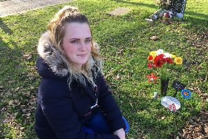 Natalie Pearson, 25, with the grave of her son Louis in Littlehampton Cemetery