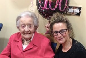 Olivia Jordan from Cranleigh at her 100th birthday party, pictured with Jo Burgess who helped with the celebrations SUS-190502-102000001