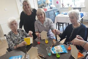 Kathleen Tapp, Caroline Thomas, Joanne Lane and Coral Cole painting birdboxes for the RSPB Big Garden Birdwatch
