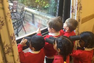 Residents and pupils during the birdwatch