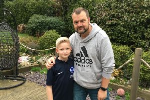 Ian Miller, 50, from Findon, with his son Alfie