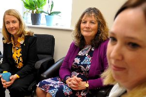 Katy Bourne and staff at Amber House listening to Enrica telling her story