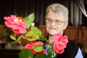 Mabs Welch with her camelia. Photo by Derek Martin DM1931685a
