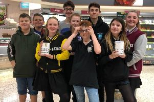 Some of the cast of 13 The Musical at Morrisons Littlehampton, where they raised money through bag packing