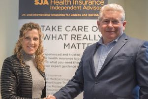 Sally Gunnell OBE with Andrew Leach, managing director of SJA