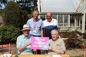 Tim Wilkins, Alzheimer's Society service user, and members of the Horsham Rusty Brains at Warnham Park in 2018.