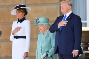 Queen Elizabeth II stands with US President Donald Trump and US First Lady Melania Trump during a welcome ceremony at Buckingham Palace on June 3.  (Photo by Toby Melville - WPA Pool/Getty Images)